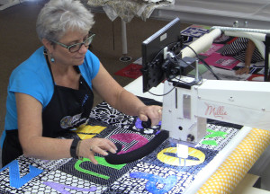 Chris quilting for a client on one of our APQS Millie machines